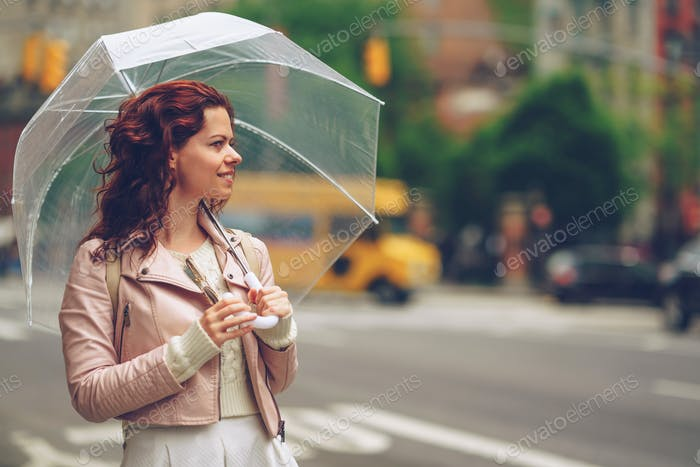 Smiling girl with an umbrella