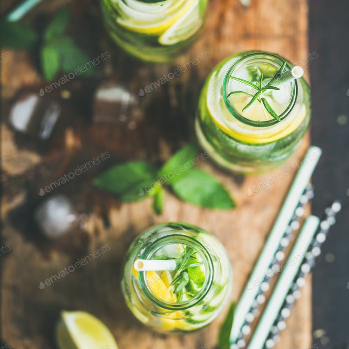 Healthy infused citrus sassi water in glass bottles, square crop