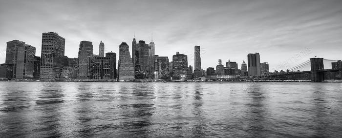 Panoramic picture of New York City skyline at dusk.