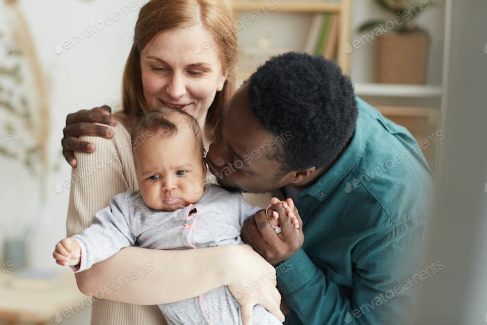 Happy Mixed Race Family Holding Baby