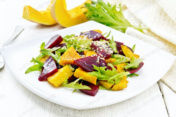 Salad of pumpkin and beetroot in plate on light board