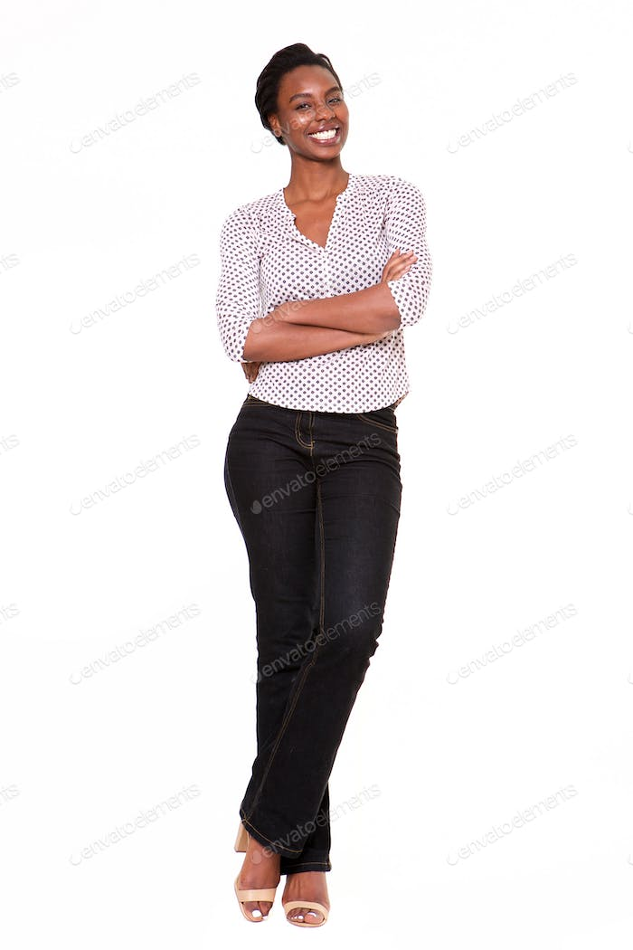 Full length beautiful young black woman standing with arms crossed