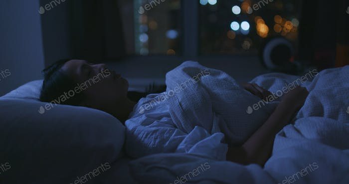Woman suffer from insomnia on bed at night