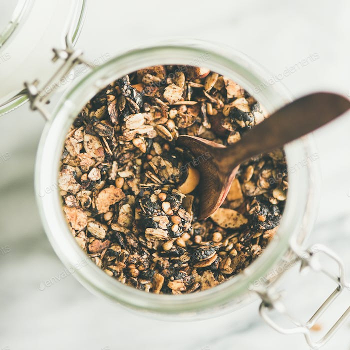Buckwheat and granola with hazelnuts in jar, square crop