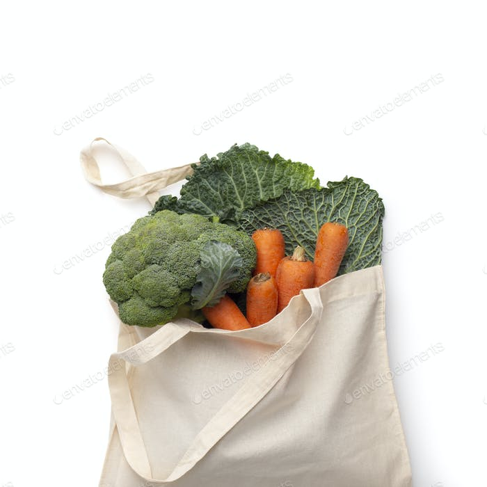 Reusable cotton bag with fresh bio vegetables isolated on white