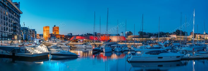 Oslo, Norway. Night View Embankment, Oslo City Hall And Moored Yachts Near Aker Brygge District