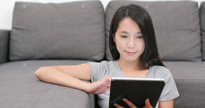 Woman use of tablet computer at home