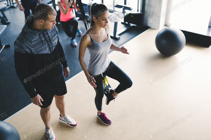 Thumbnail for Personal trainer assisting woman lose weight