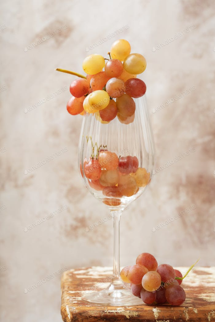 Bunch of pink grapes over rustic background