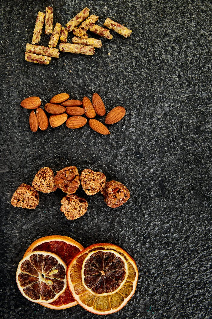 Healthy snacks -  variety oat granola bar,  rice crips, almond,   dried orange