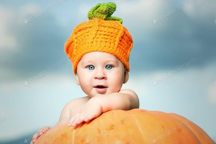 Little kid in pumpkin