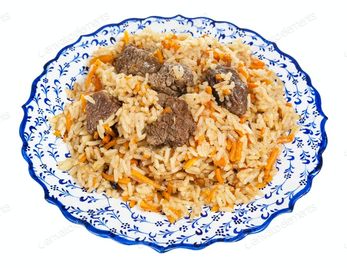 above view of prepared pilau on local ceramic plate