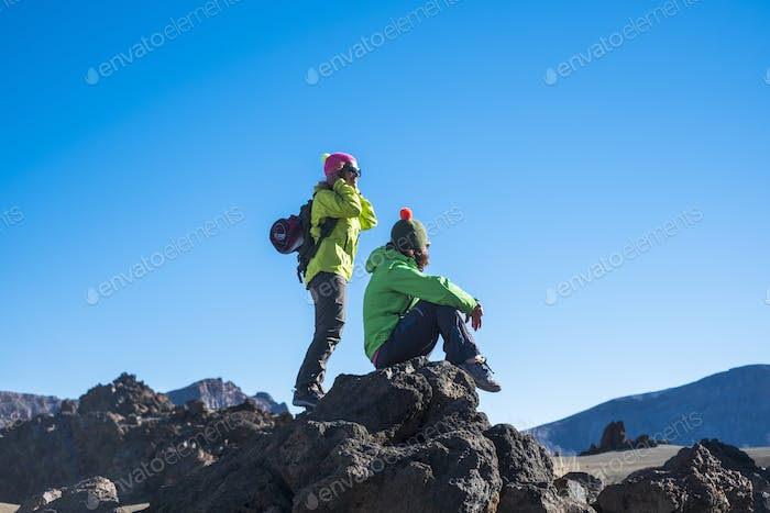 Couple of female people enjoying the outdoor sport leisure actiity at the mountain