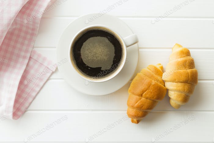 Sweet tasty croissants and coffee cup.