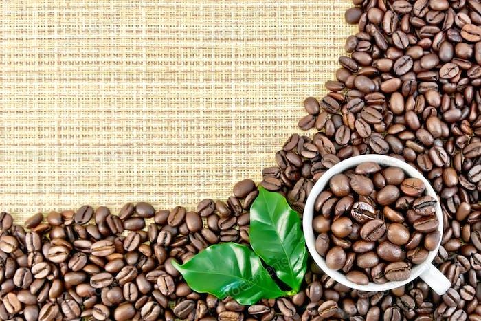 Coffee black grains on yellow woven fabric