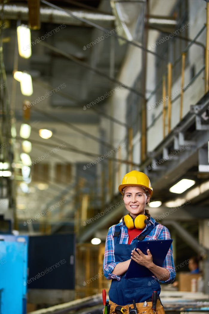 Female Factory Worker Smiling at Camera