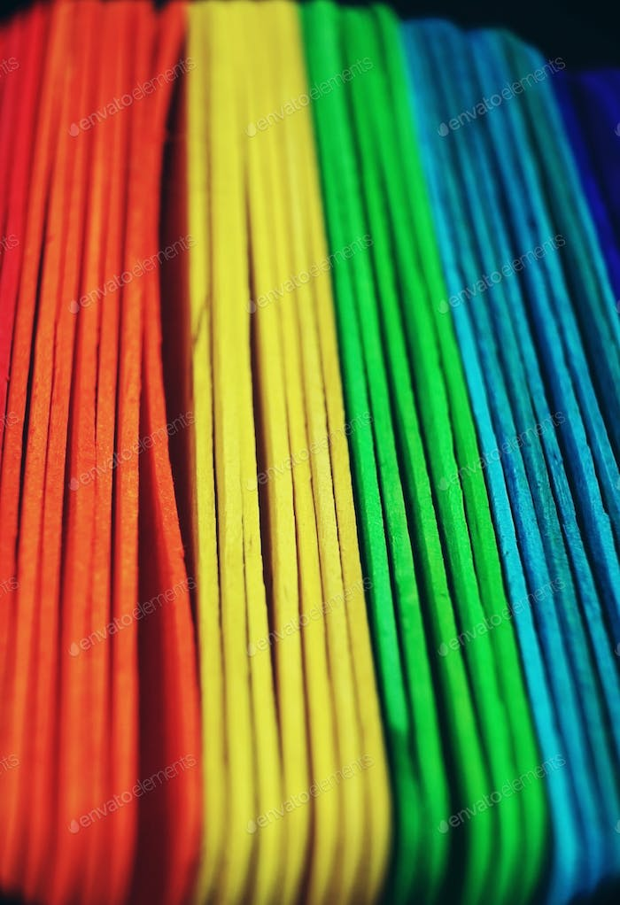 Rainbow abstract macro done with colorful wooden sticks
