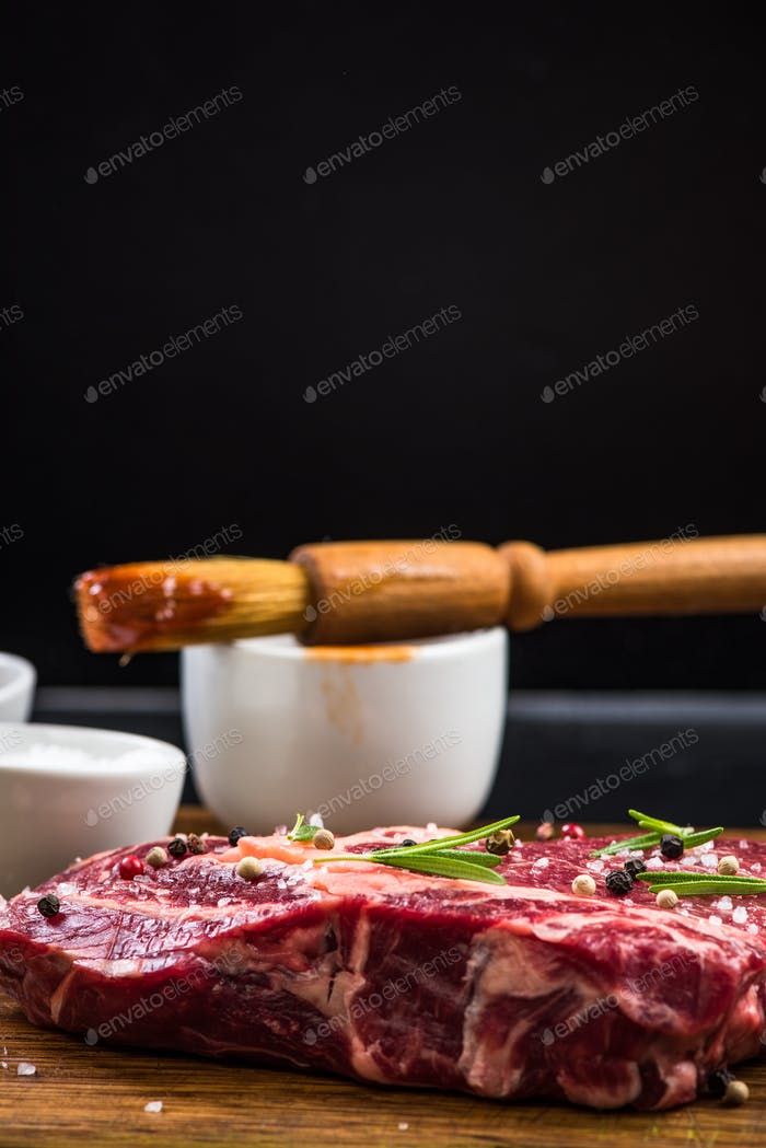 Raw beef meat with herbs and spices