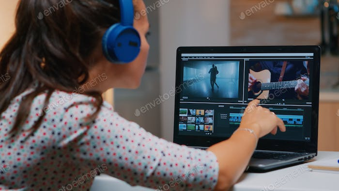 Videographer working on laptop from home