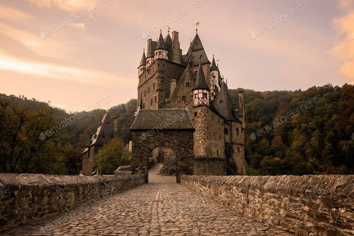 Burg Eltz Castle at sunrise in autumn