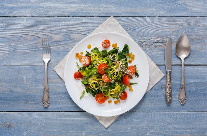 Restaurant dish - vegetable salad on rustic table