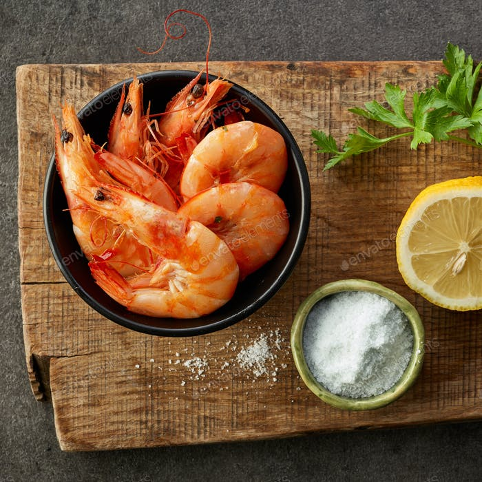 roasted prawns on wooden cutting board
