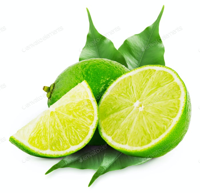 Whole and slices of lime with green leaves