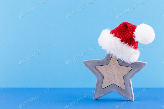 Christmas star, decor on pastel colored background.