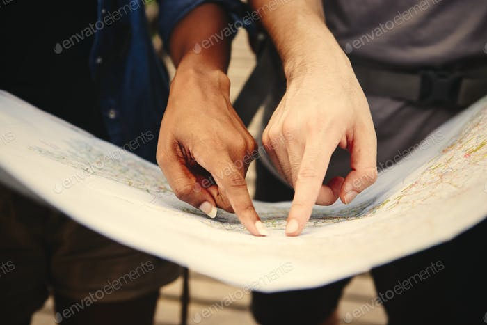 Friends finding directions with a map