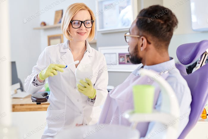 Female Dentist Explaining Hygiene Rules