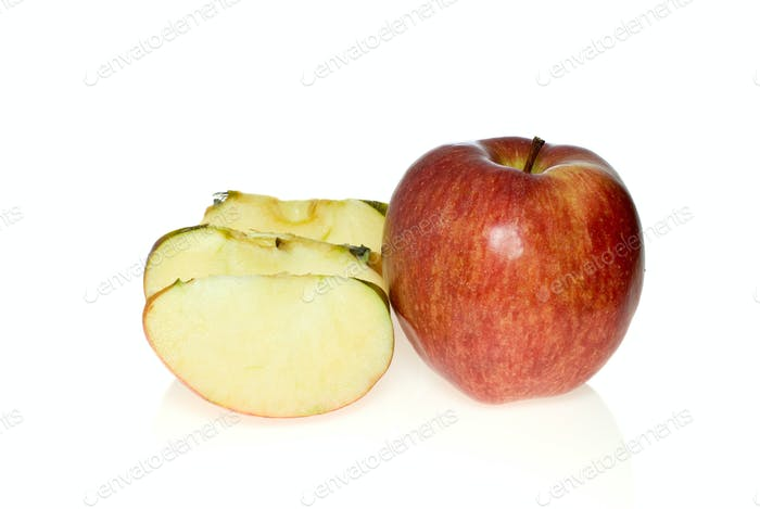 One whole red apple and few slices