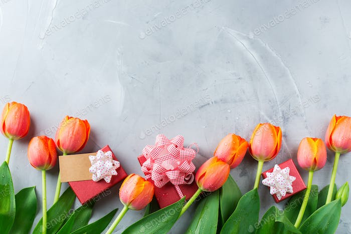 Spring background with orange tulips. women, mother day, greeting card
