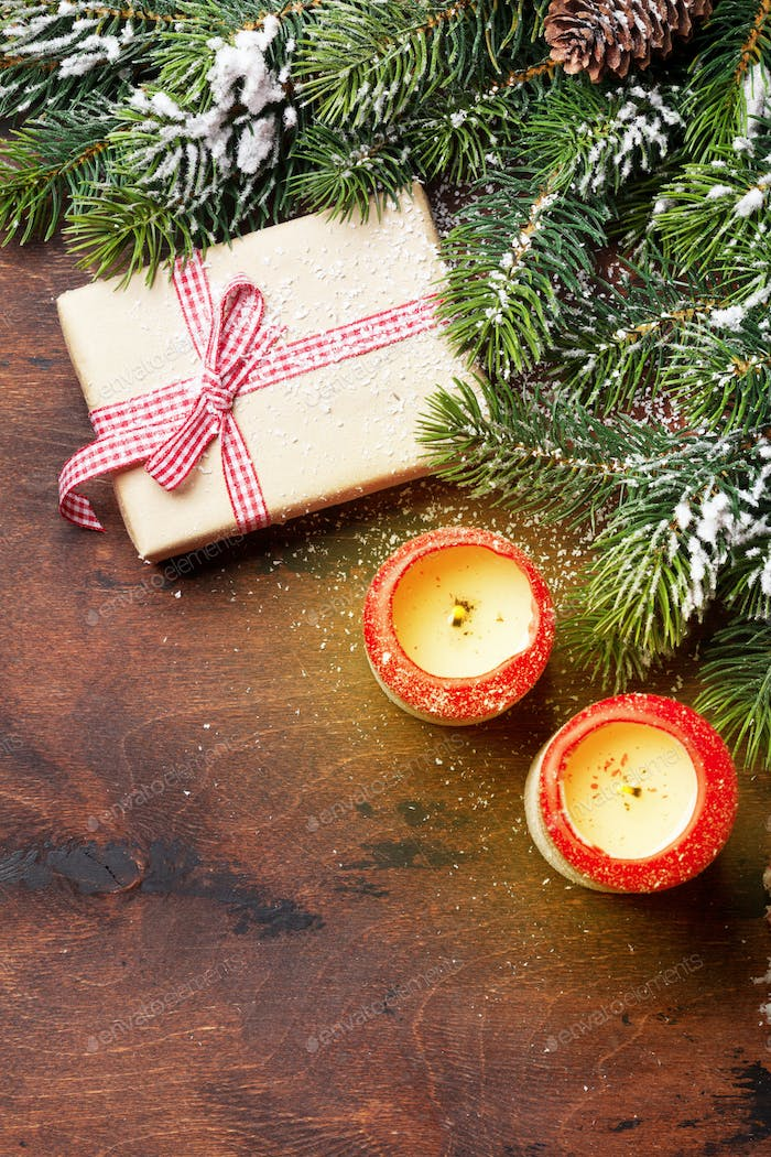 Christmas gift, candles and fir tree branch