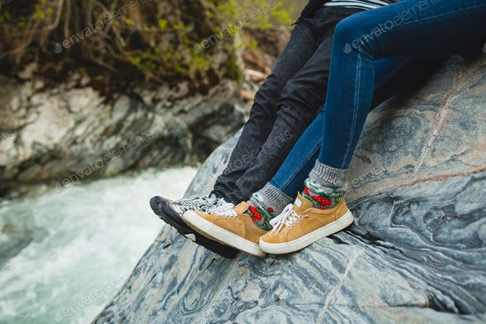 young hipster couple on winter vacation legs close-up