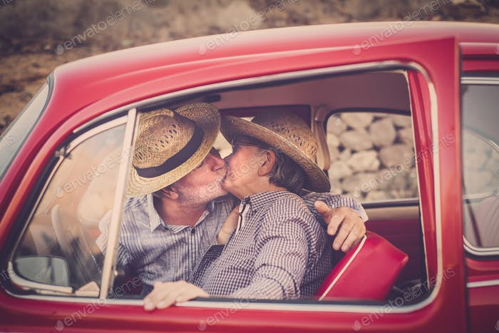 Elderly couple in love during travel by car
