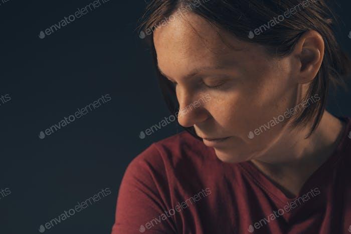 Sensual melancholic female portrait, no makeup and no retouching