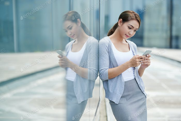 Business lady reading messages