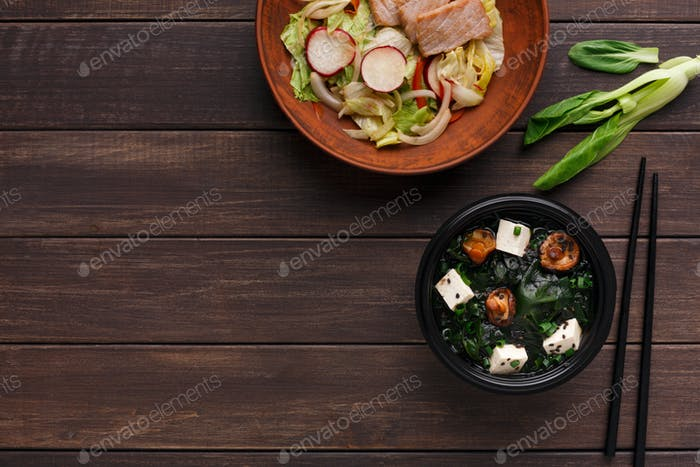 Bowl of rice noodles on wooden background