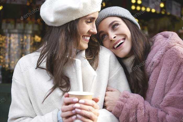 Two best friends enjoying time on Christmas market