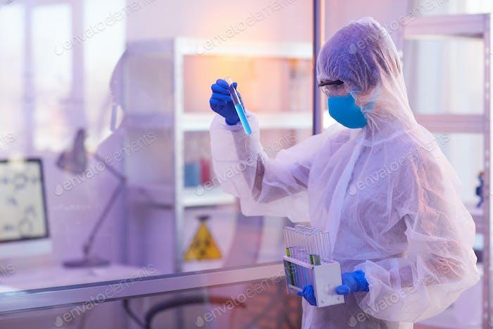 Female Pharmacologist Choosing Test-Tube