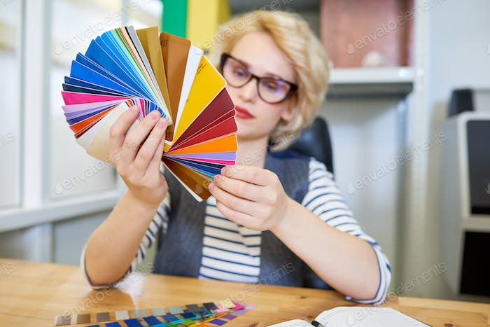 Designer looking at color samples
