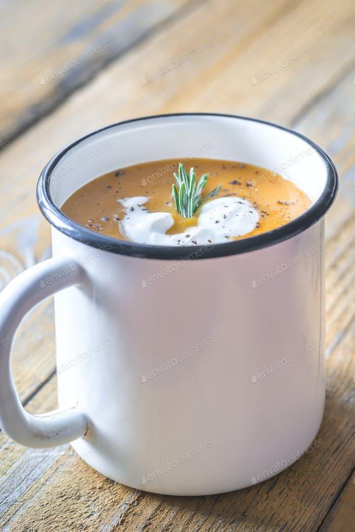 Mug of pumpkin cream soup