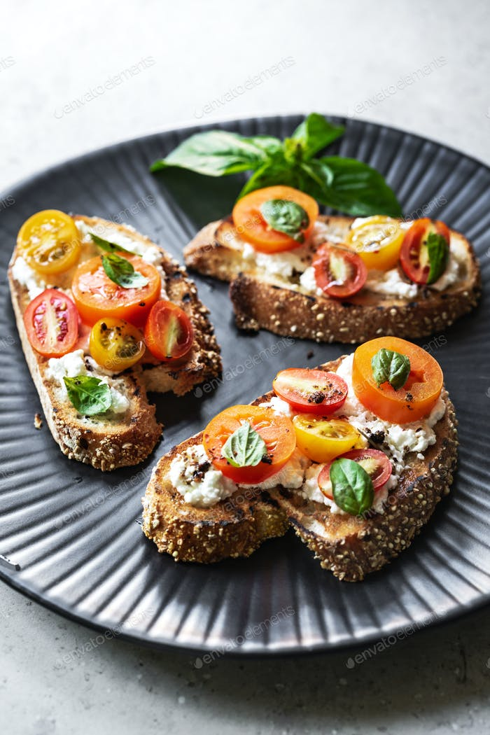 Cherry Tomatoes and Ricotta Bruschetta by Herbs Olive oil