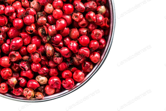 Red pepper seeds in pot isolated on white