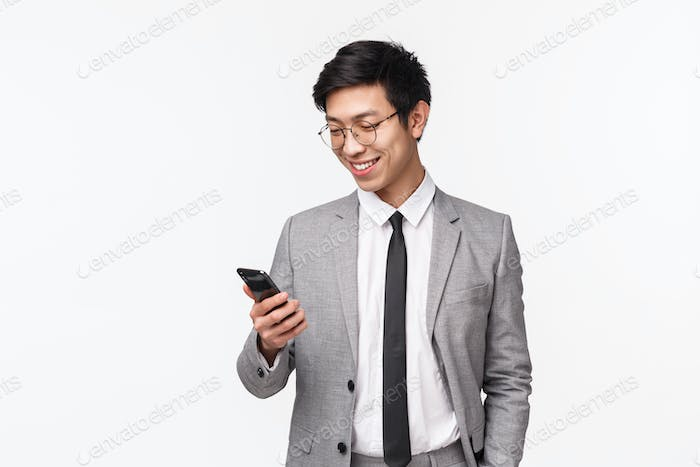Technology and finance concept. Waist-up portrait of pleased handsome male entrepreneur, company