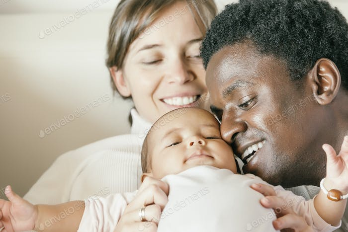 Happy Family, Mother, Father And Baby.
