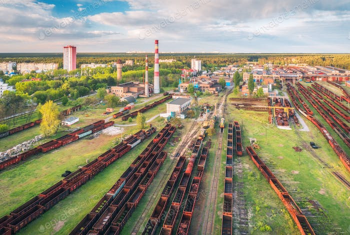Aerial view of freight trains. Railway station with wagons