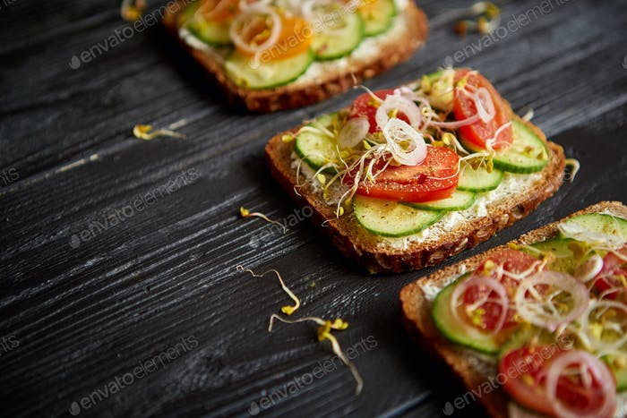 Row of three healthy vegetable toasts