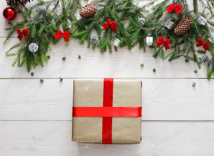 Christmas present gift and ornaments on white wood background