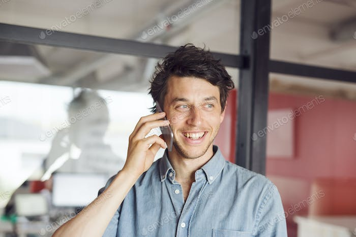 Mid adult man talking on phone